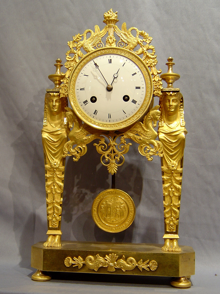 Antique French Directoire Goute D'Egypt ( Egyptian style) ormolu mantel clock.
