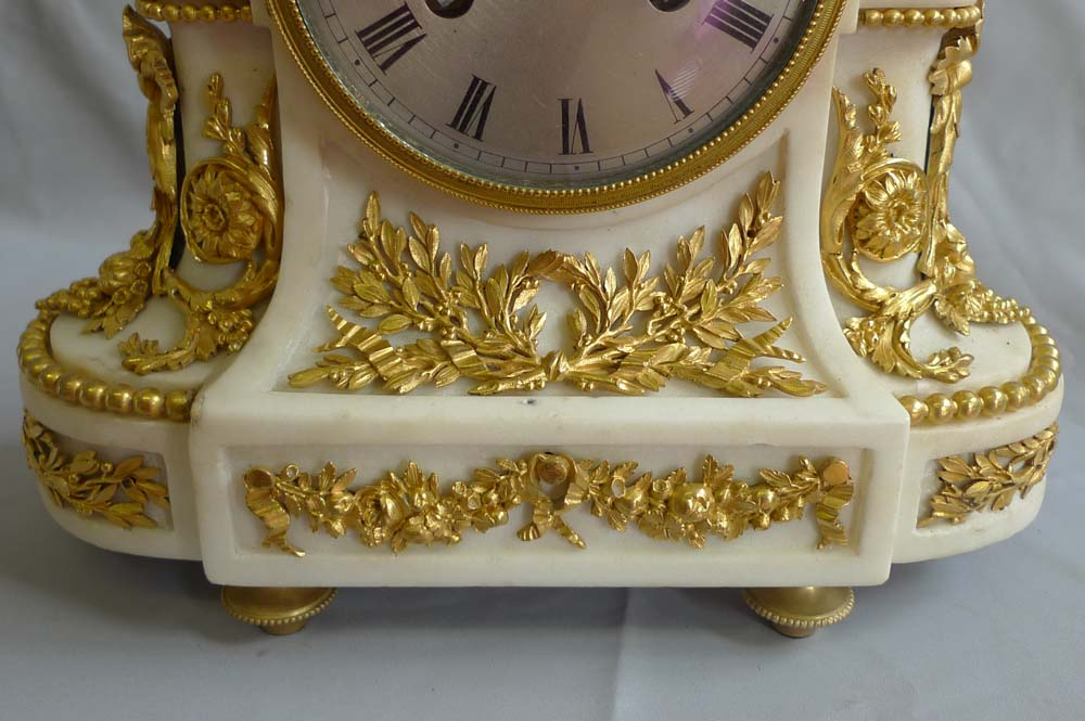 Antique French mantel clock of Venus and Cupid in marble and ormolu.
