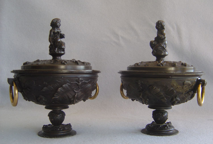 Pair of antique French patinated bronze lidded urns.