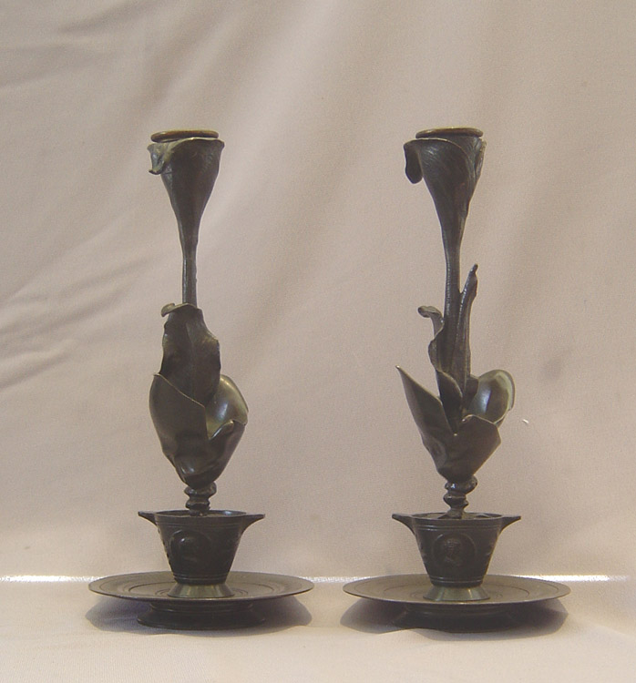 Antique French patinated bronze candlesticks in the form of a lily in a pot.