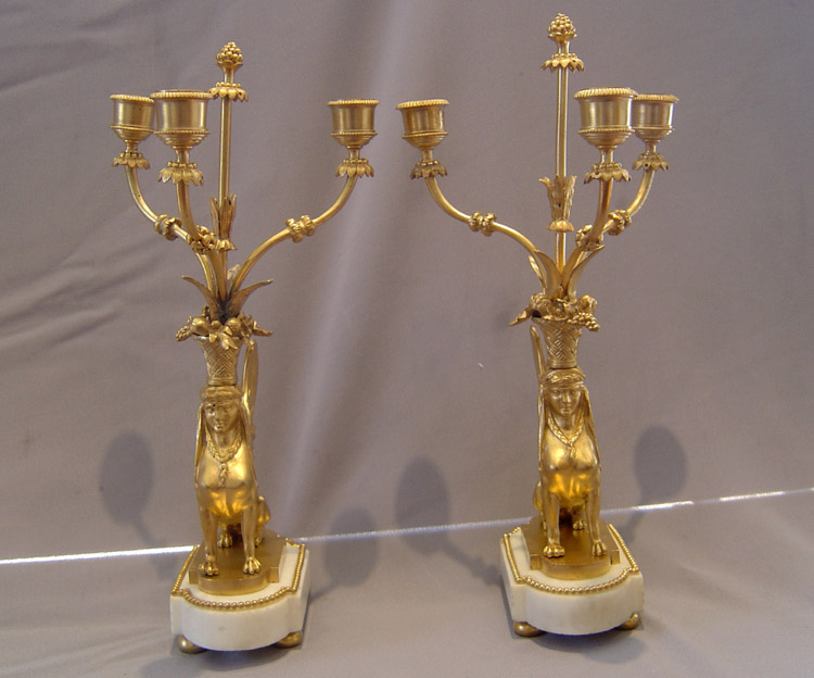 French antique sphinx candelabra, a pair in ormolu and white marble.