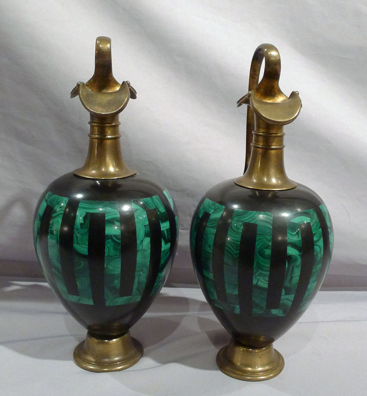 Antique pair of Russian malachite and black marble vases with ormolu mounts.