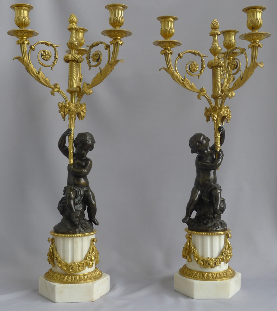 Antique pair of large French figural candelabra in patinated bronze, ormolu and white marble