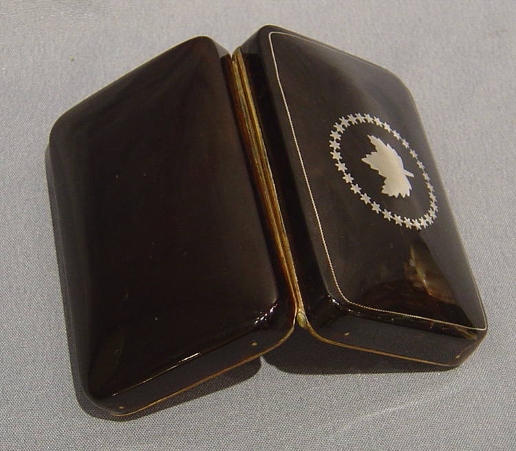 Antique tortoiseshell and silver snuff box with  maple leaf.