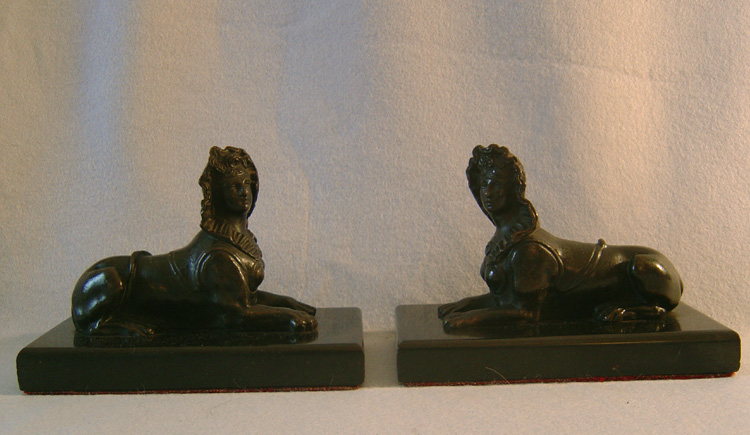 Antique pair of Grand Tour Sphinx on black marble bases.