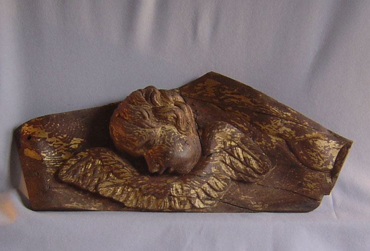 Italian antique 17th century carved and gilded winged head of putti or cupid.