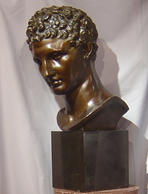 Large bronze bust of male on marble base.