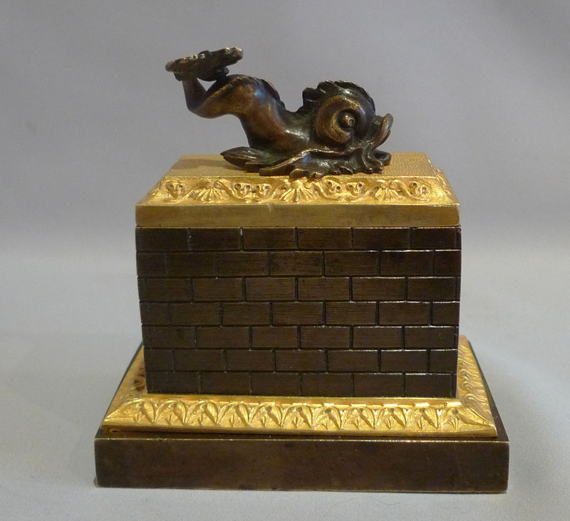 Antique English Regency inkwell in patinated bronze and ormolu with dolphin mount.