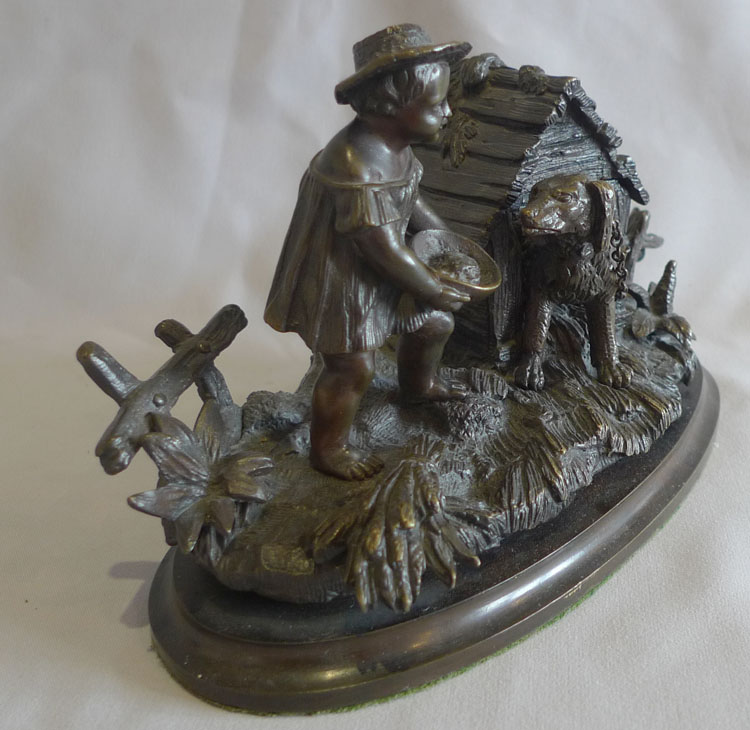Antique French inkstand and pen holder with dog in kennel and boy.