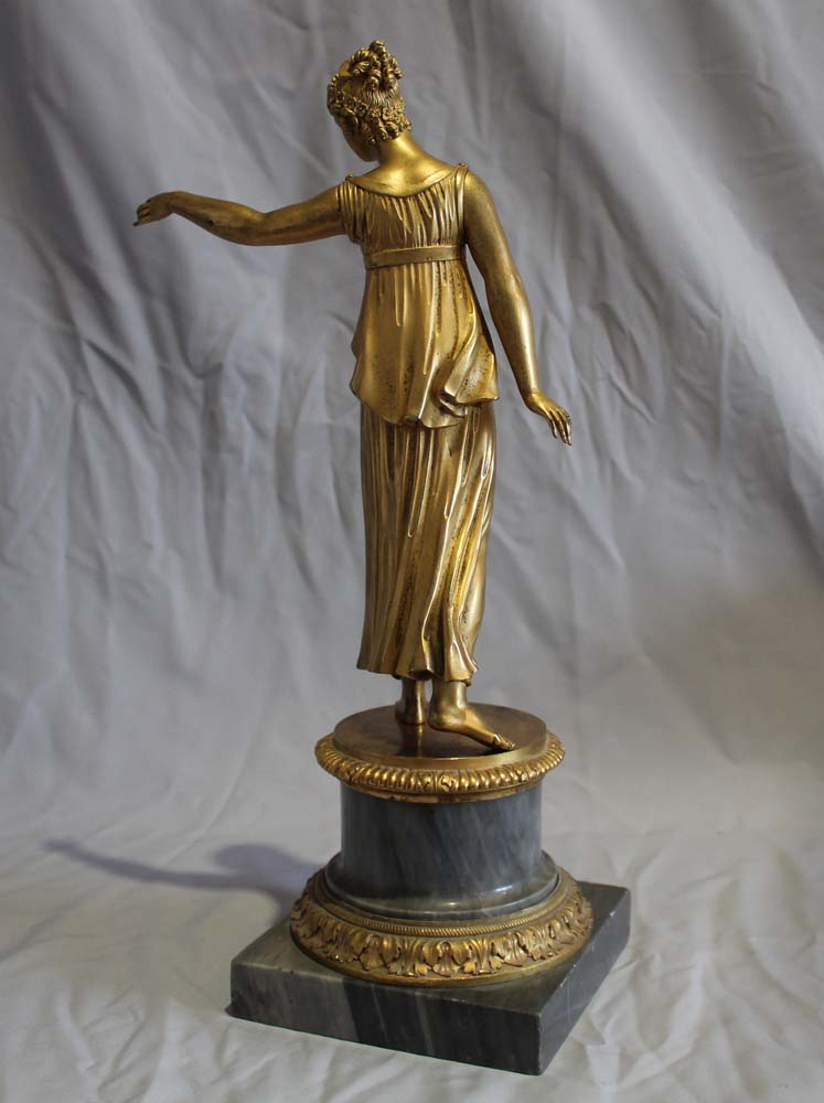 Antique French Louis XVI ormolu statue of a woman on Blue Tarquin ormolu mounted marble base.