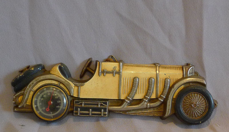 Vintage tin plate classic sports car thermometer.
