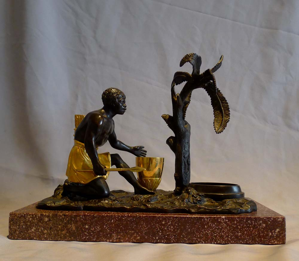 Antique French Directoire gilt and patinated bronze mounted ecrier of blackamoor.