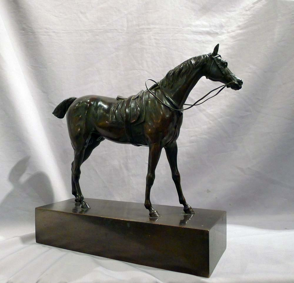 Antique French Charles X period patinated bronze of a Racehorse on rectangular bronze base.