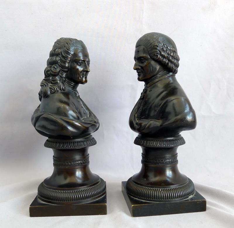 Pair of Antique busts of Rousseau and Voltaire.