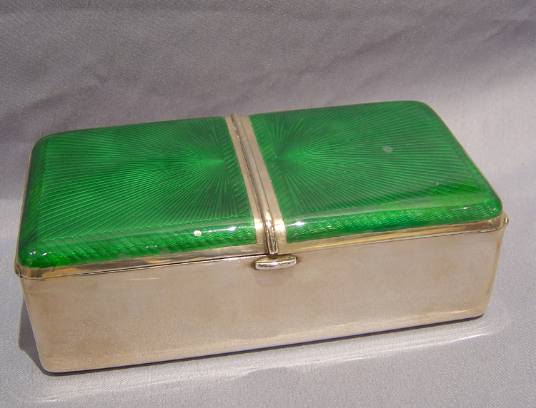 Antique silver and green guilloche enamel cigarette box.