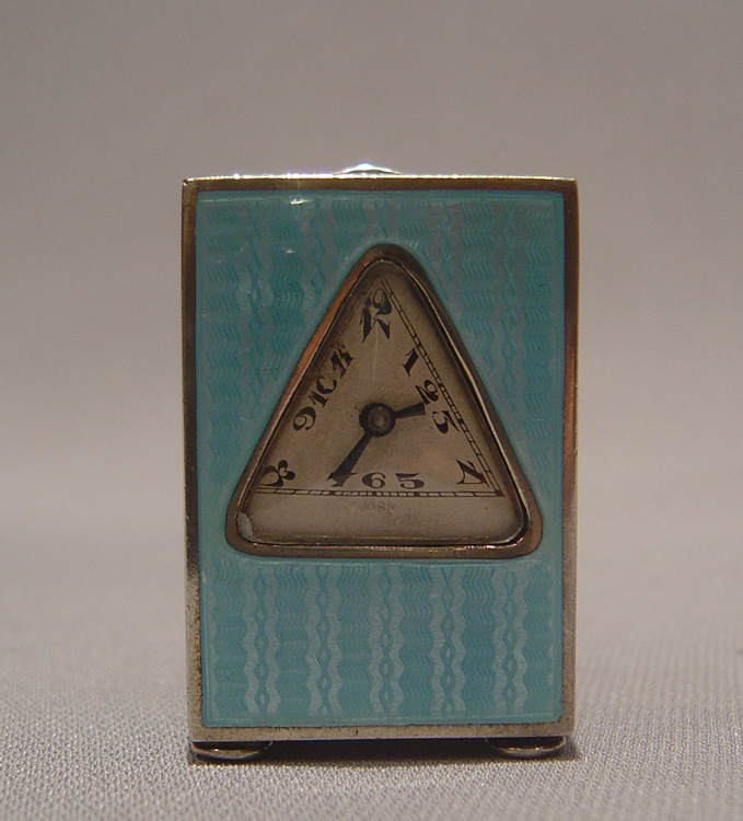 Silver and blue guilloche enamel miniature carriage clock with triangular dial.