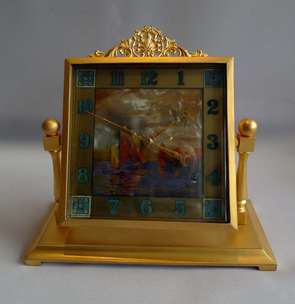 Mother of pearl, enamel and gilt bronze English boudoire clock.