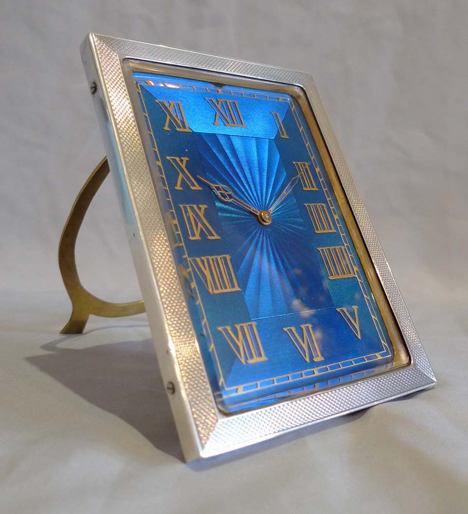 Strut clock in silver and petrol blue guilloche enamel.