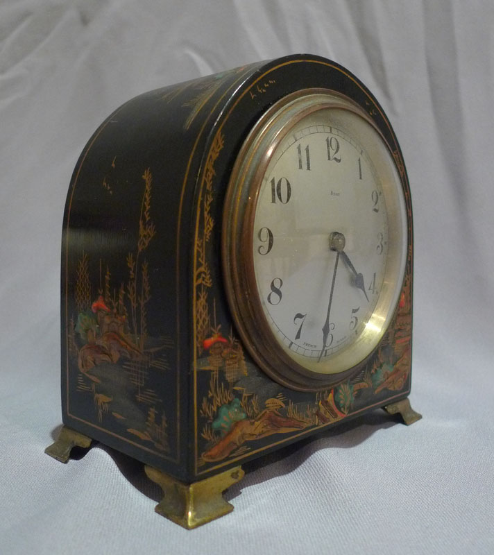 Dome topped black lacquer and chinnoisserie decorated mante clock