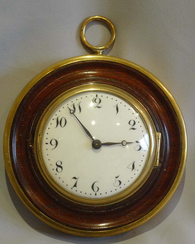 Antique late 18th century Sedan clock in mahogany and brass with later 8 day movement.