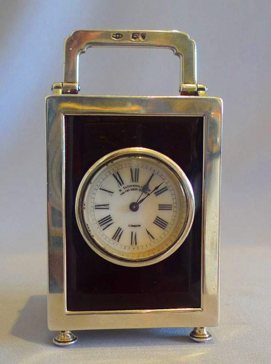 Antique silver and foil backed glass carraige clock by Thornhill & Co