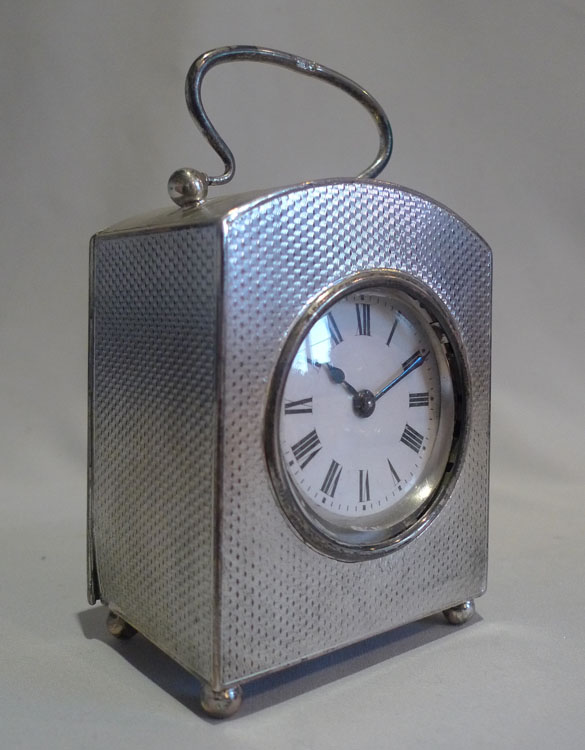 Antique Edwardian silver engine turned case carriage timepiece.