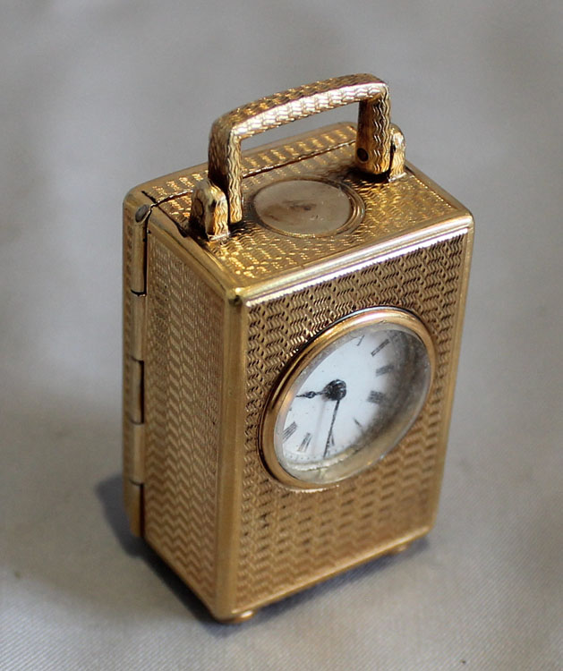 Antique English Silver Gilt sub miniature carriage clock.