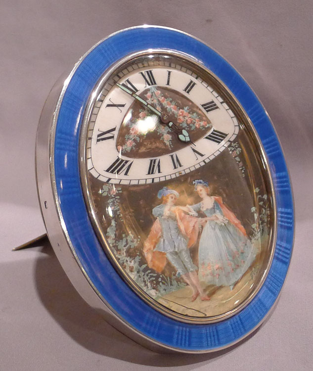 French silver and guilloche enamel timepiece with hand painting on ivory.