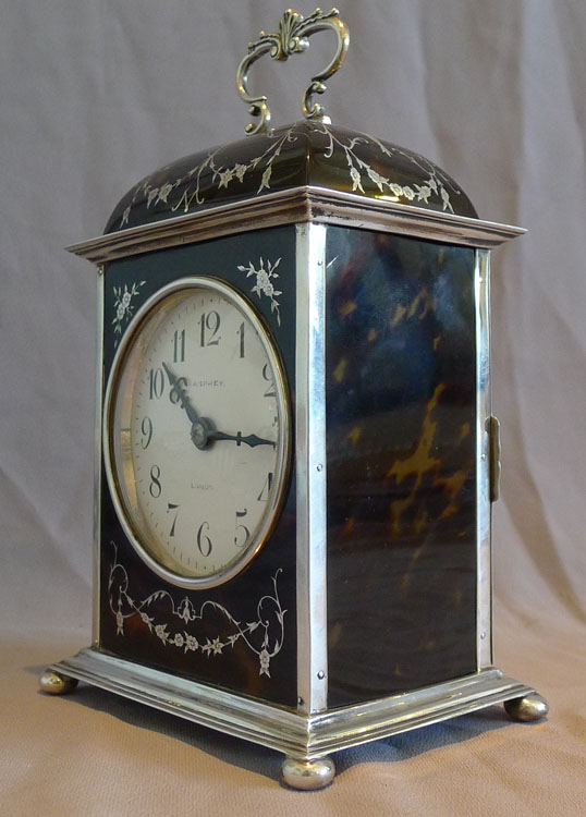 Antique silver and tortoiseshell pique large striking mantel clock signed Asprey.