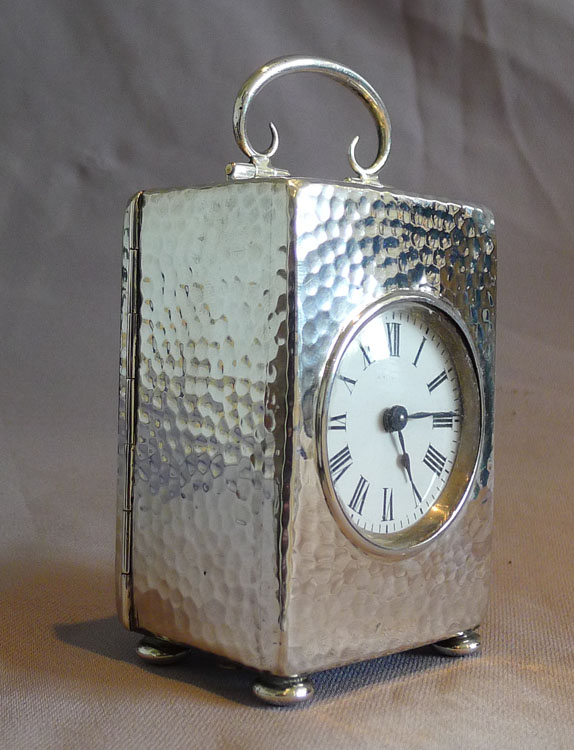 Antique English Edwardian hammered silver carriage clock in velvet lined case.