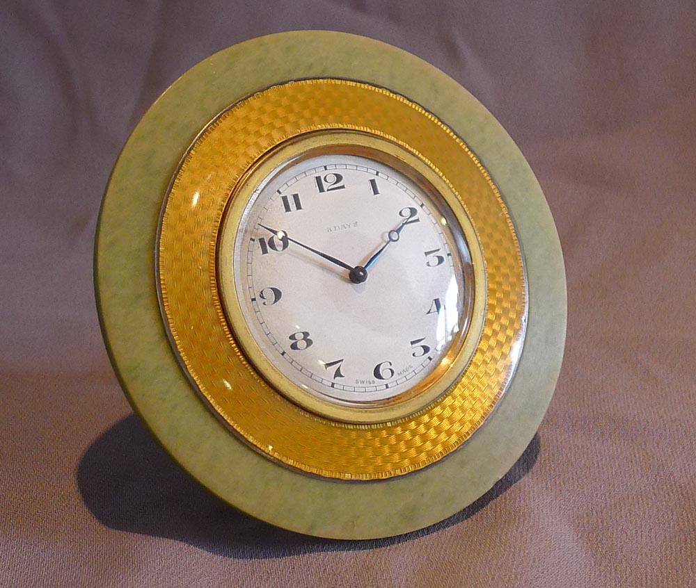 Silver, Imperial yellow Guilloche enamel, green marble and brass strut clock.