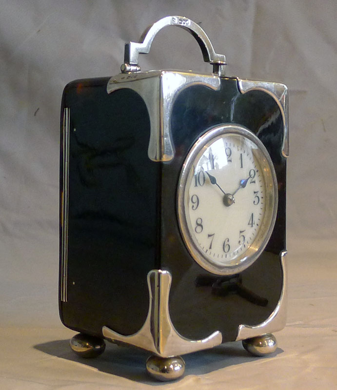 Antique silver mounted tortoiseshell carriage clock with strike and repeat