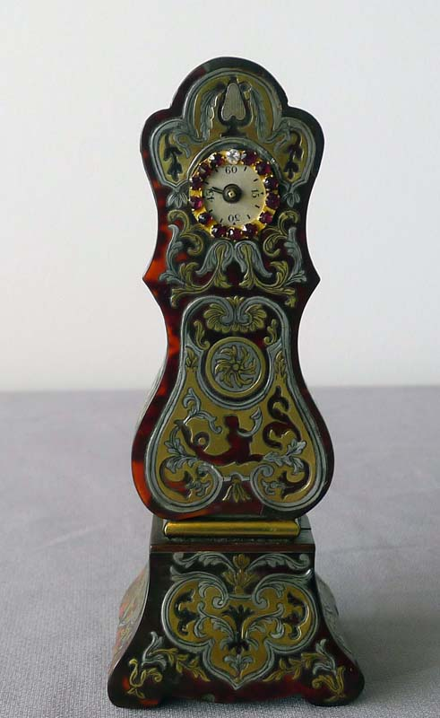 Antique miniature scarlet tortoiseshell, pewter and brass boulle longcase clock with jewelled dial.