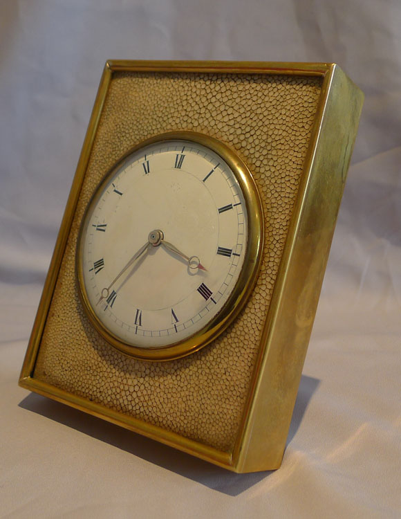 A fine antique English Edwardian shagreen and gilt bronze strut clock.