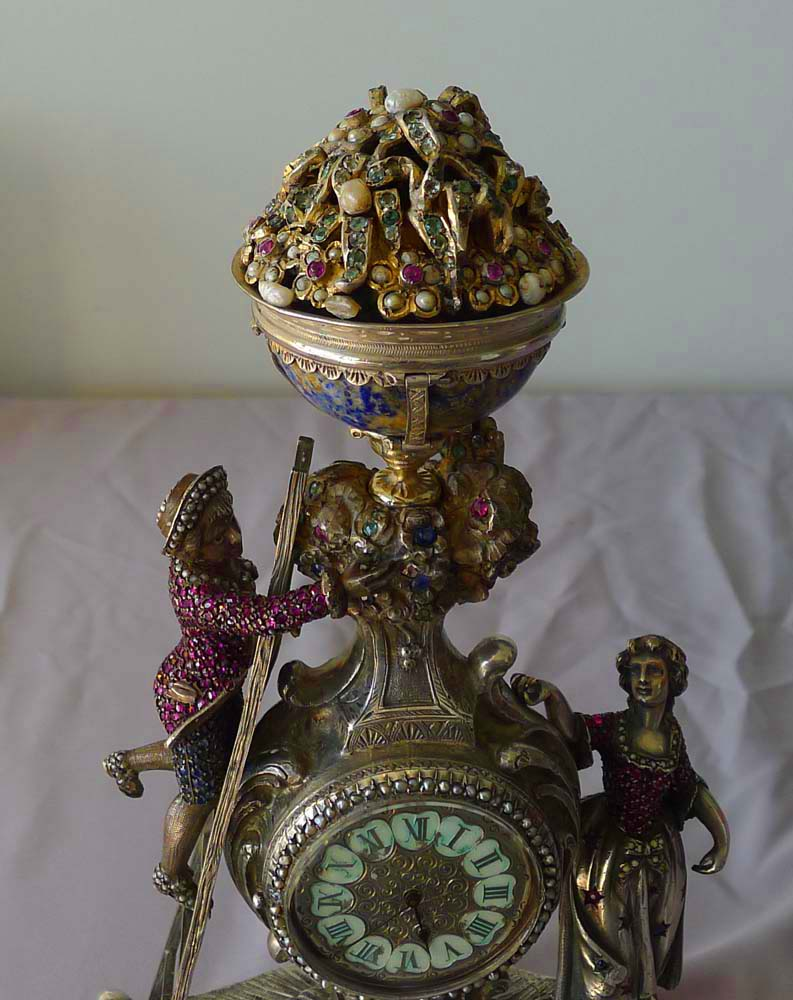 Spectacular antique Viennese silver and jewelled clock of young couple picking fruit from a tree.