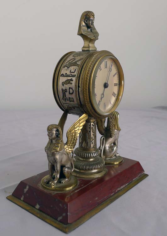 Fine and unusual desk timepiece of Retour d'Egypt or Egyptian Revival in gilt and silvered bronze.