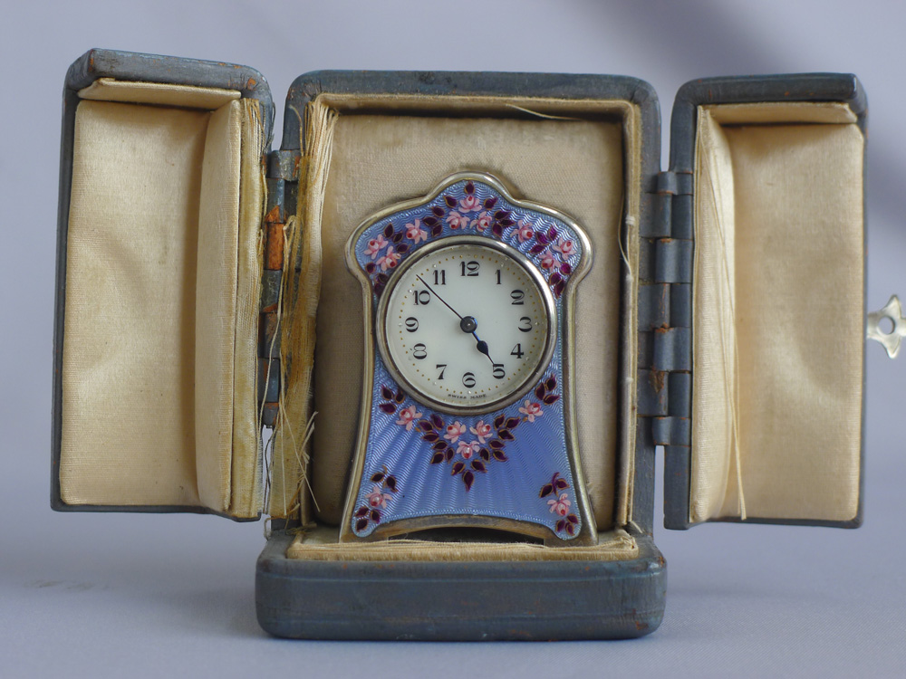 Silver and enamel boudoir clock in original leather fitted case