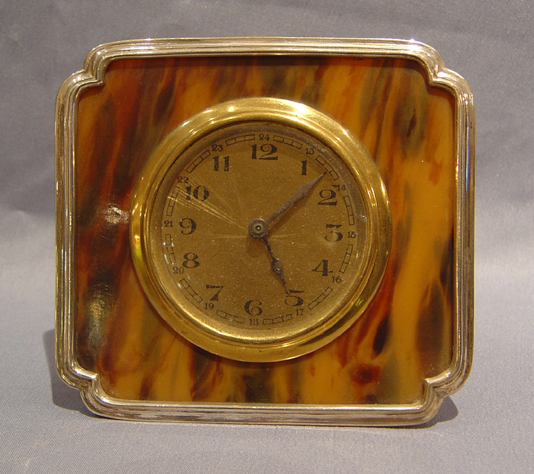 Antique English silver & tortoiseshell strut clock.