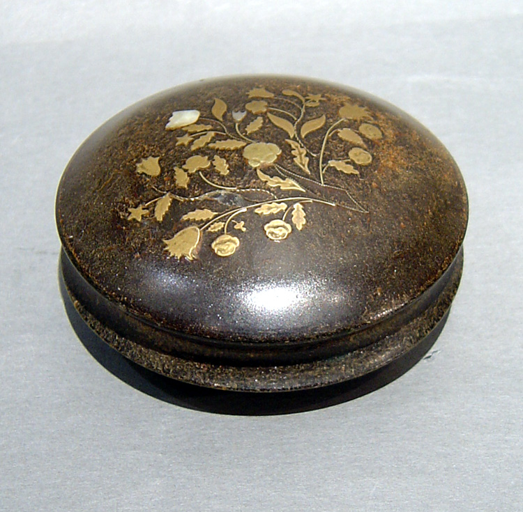 antique English tortoiseshell box inlaid with gold and abalone.