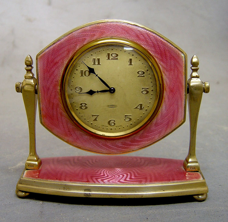 English silver & pink guilloche enamel mirror strut clock in case.