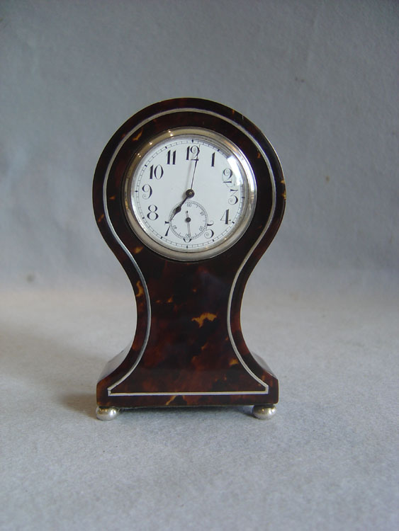 Tortoiseshell and silver small balloon clock