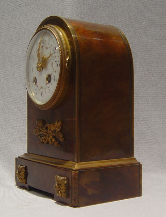 French antique dome topped tortoiseshell and bronze mounted mantel clock.