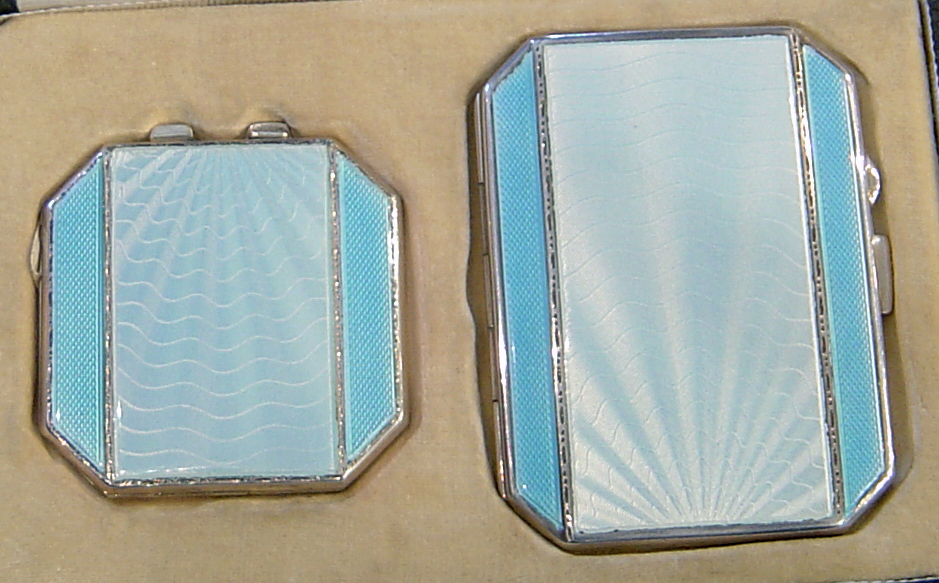 Art Deco silver and enamel compact set.
