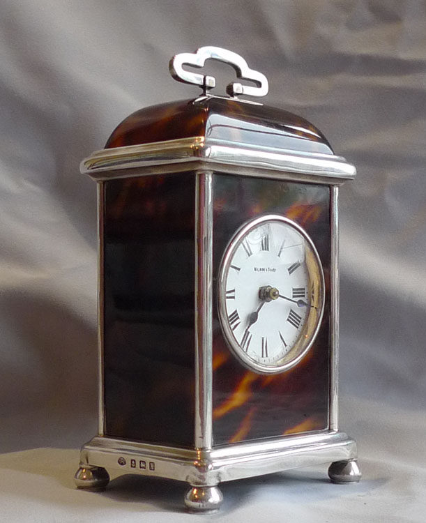Tortoiseshell and silver dome topped carriage or mantel clock.