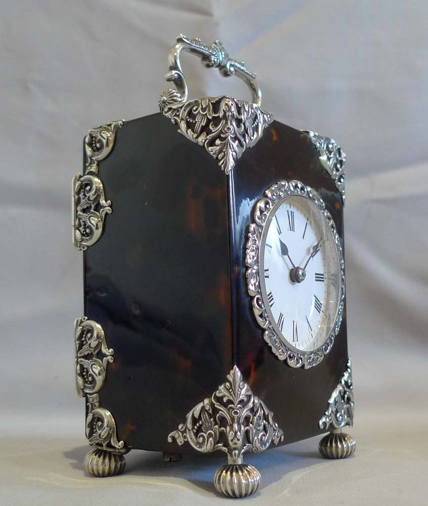 Antique English silver mounted & tortoiseshell carriage clock of substantial size.