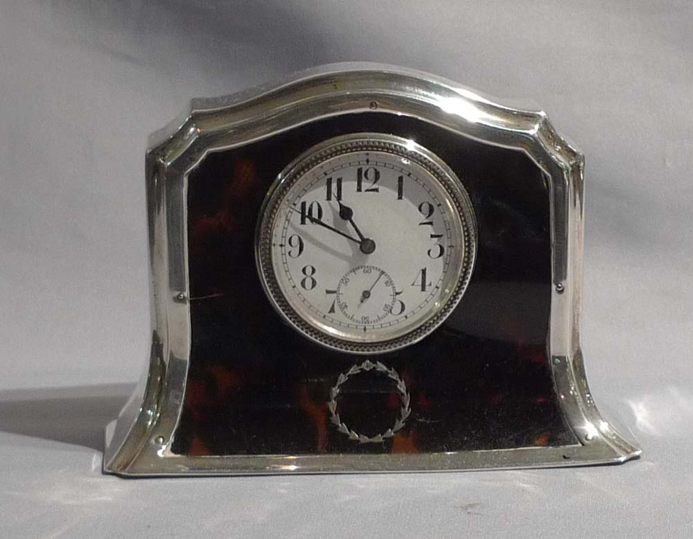 Silver and tortoiseshell pique mantel clock.