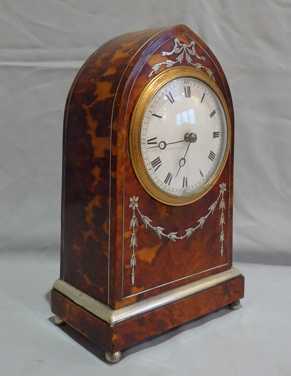 Fine antique tortoiseshell and silver inlaid lancet shaped mantel clock.
