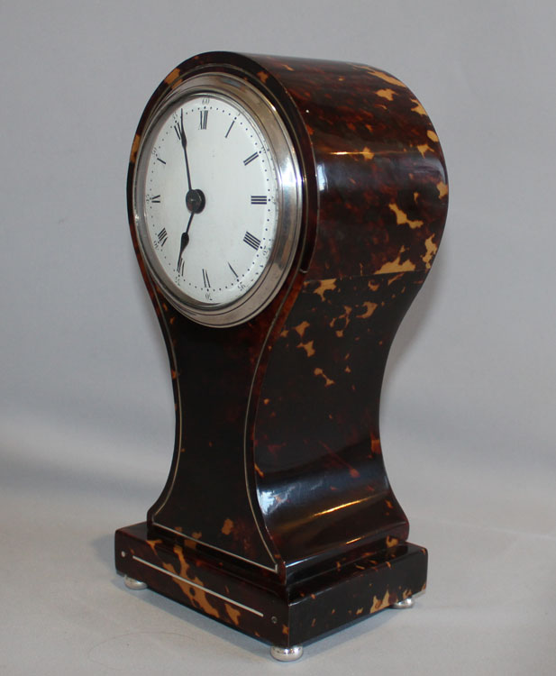 Antique English tortoiseshell and silver strung balloon shaped mantel clock.