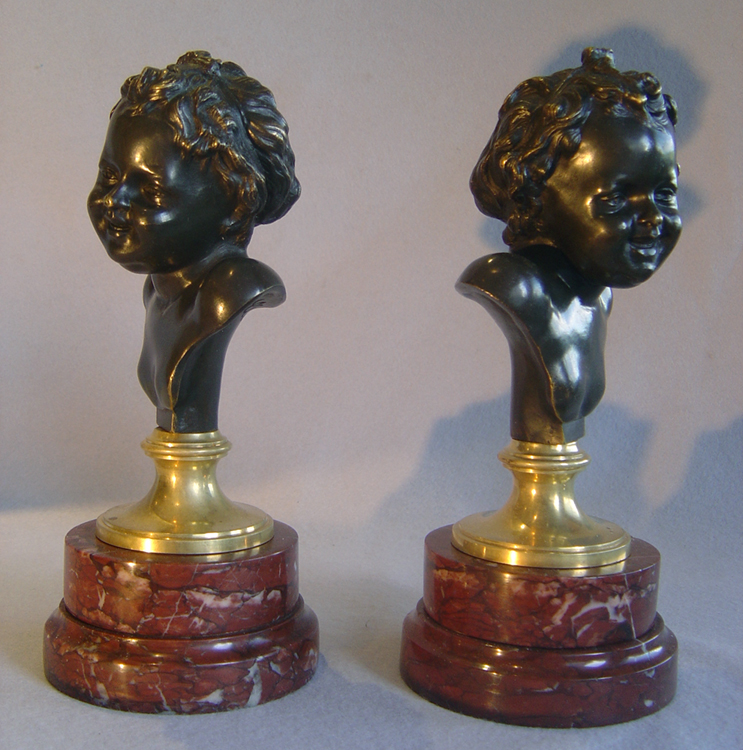 Antique French pair of heads of laughing children after