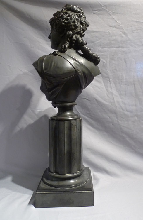 Antique French bronze bust of a classical maiden on reeded marble base.